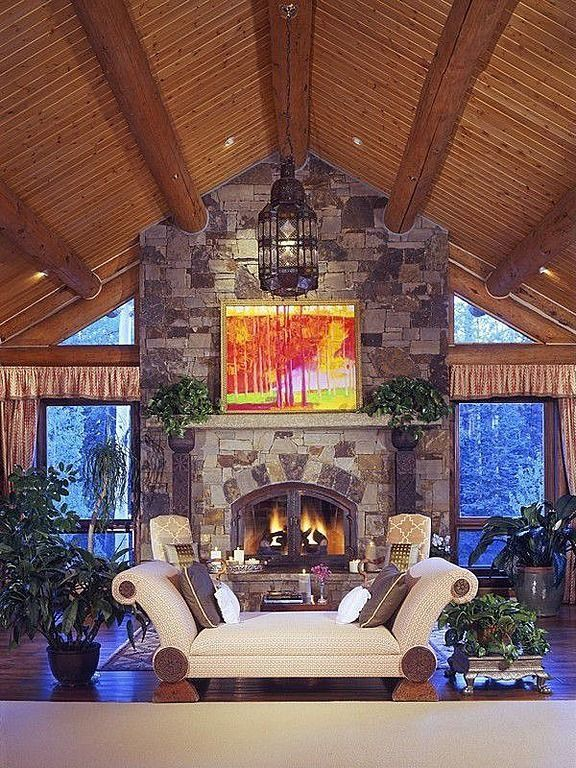 A Stone Fireplace, Vaulted Ceilings And Antler Chandelier Add Rustic  Character To This Mountainside Living · Cozy FireplaceFireplace IdeasVaulted  ... Part 49