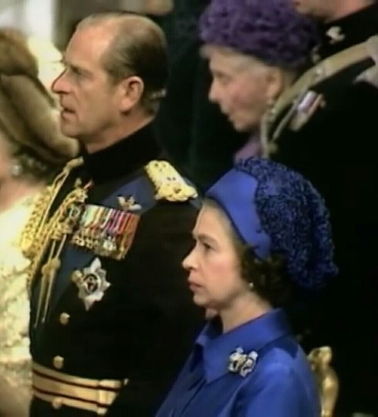 """1973: The Queen and The Duke of Edinburgh at the Wedding of Princess Anne and Mark Philips as the congregation sings the National Anthem, """"God Save the Queen"""""""