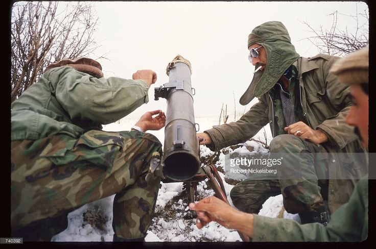 Guerrilla soldiers load a BM-12 launcher near a remote base in the Safed Koh Mountains February 10, 1988 in Afghanistan. A Soviet-supported communist coup by the People's Democratic Party of Afghanistan led to the USSR's 1979 invasion of the Islamic nation, resulting in ten years of civil war between the Russian-led government and the US-backed Afghan rebels.