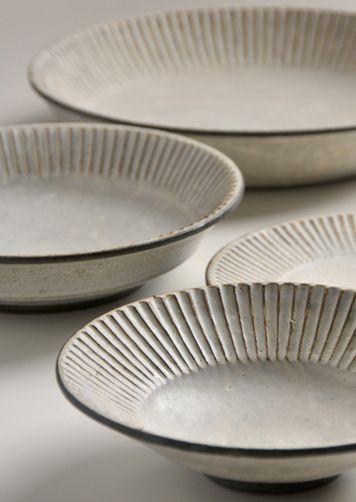 #1 (Pleated work) plates  by Japanese ceramic artist Akio Nukaga (b.1963). via the artist's site