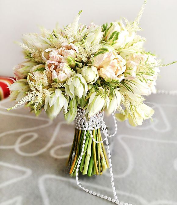 A feminine parrot tulip wedding bouquet.