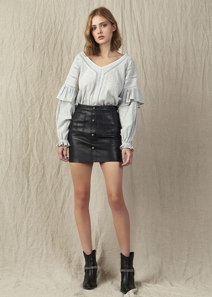 V-neck linen blouse with ruffles and cuff sleeves and black leather mini skirt. Model - Kerryn @ IMG Beauty - Isabella Schimid @ Union Management Photographer - John Rintoul. #AjeTheLabel #Aje #Fashion #Style #LookBook #AW17 #Autumn #Winter #2017 #AustralianFashion #Designer