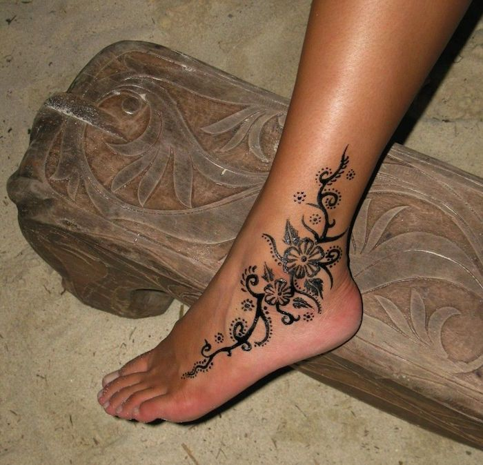 Henna Foot Tattoo In Black On The Side Of The Ankle Of A Woman S Foot Stepping On Fine Li In 2020 Ankle Tattoos For Women Hand Tattoos For Women Foot Tattoos For Women