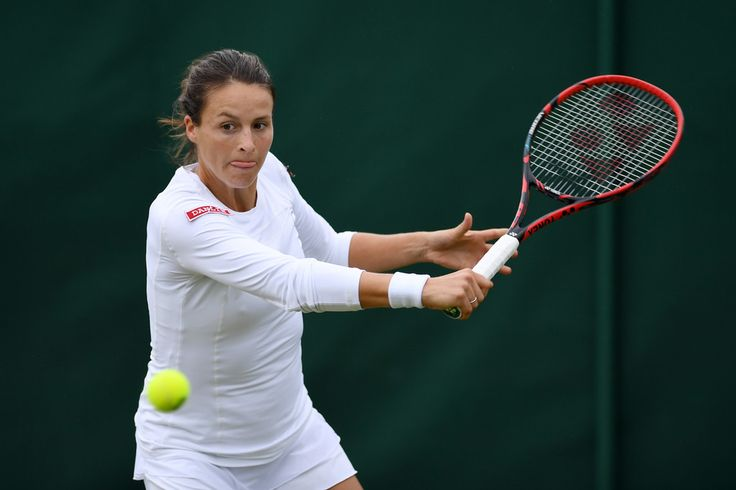 Tatjana Maria Photos Photos - Tatjana Maria of Germany plays a forehand during the Ladies Singles first round match against Julia Boserup of the United States on day three of the Wimbledon Lawn Tennis Championships at the All England Lawn Tennis and Croquet Club on June 29, 2016 in London, England. - Day Three: The Championships - Wimbledon 2016