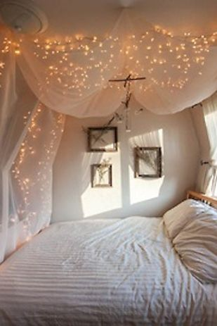Or hang christmas lights behind sheer curtains for a luminescent effect. | 21 DIY Ways To Make Your Child's Bedroom Magical