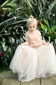 Adorable little girl wearing a tulle skirt and sweater