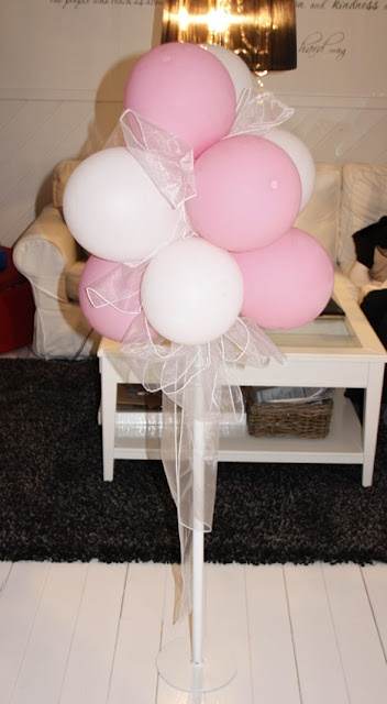 DIY No-helium balloon decoration - You need a tripod (mine is a 20 inch steel plate welded pipe ) And 10 balloons. Blow up the balloons, until they are almost hard.  Tie one of each color, and put the cross on top of each other.   Use organza ribbon to fill in gaps