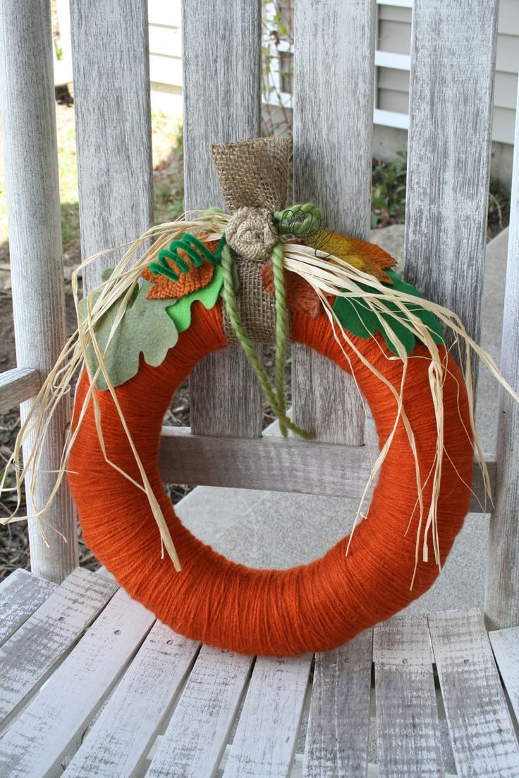 Pumpkin Yarn Wreath/Fall Wreath via Etsy.  Definite possibilities for some crochet twists!