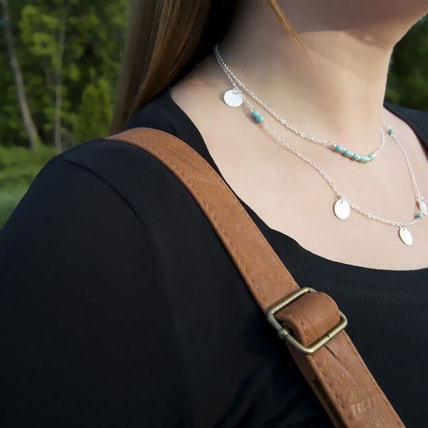 This multi-layered necklace features a variation of turquoise beads and charms! Great for all occasions.