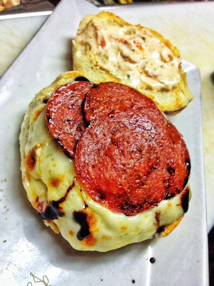 topped with melting provolone cheese, pepperoni, oven roasted tomato ...