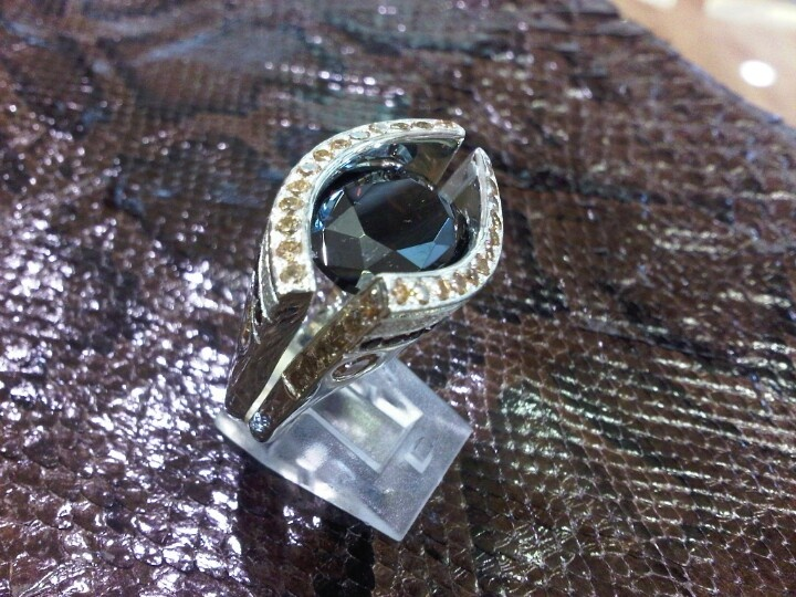 Sterling Silver Ring set with a Garnet an small cubic zirconia's