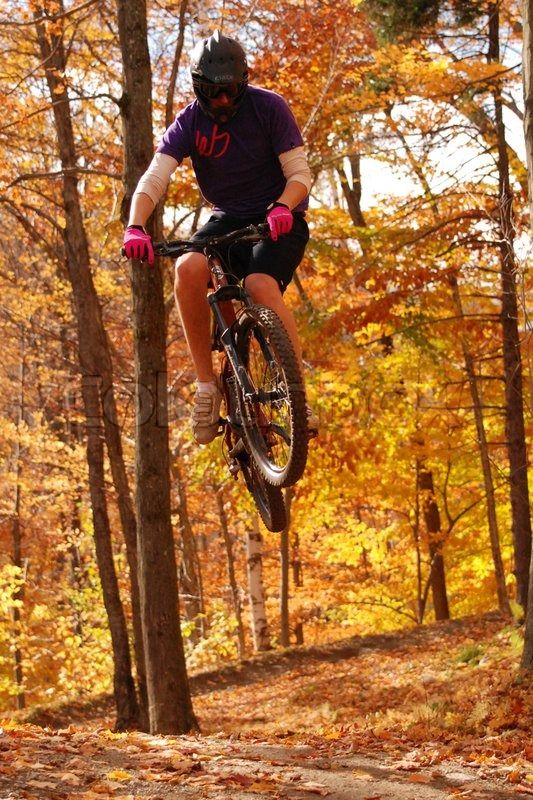 Stock Image Of Adolescent Jumping With Mountain Bike
