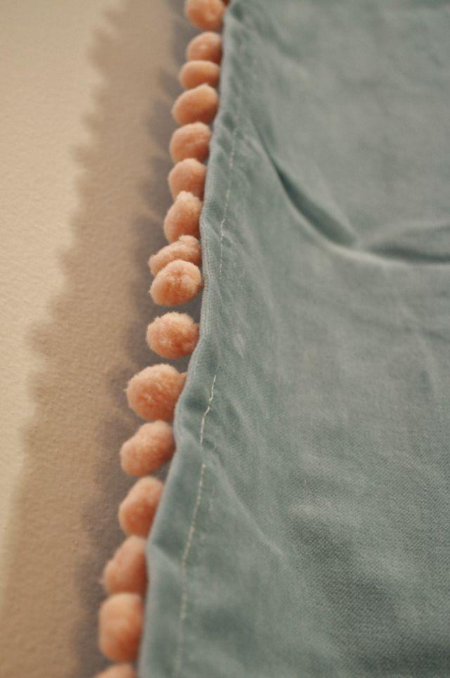 Peach pompom trim sewed on IKEA turquoise velvet curtains