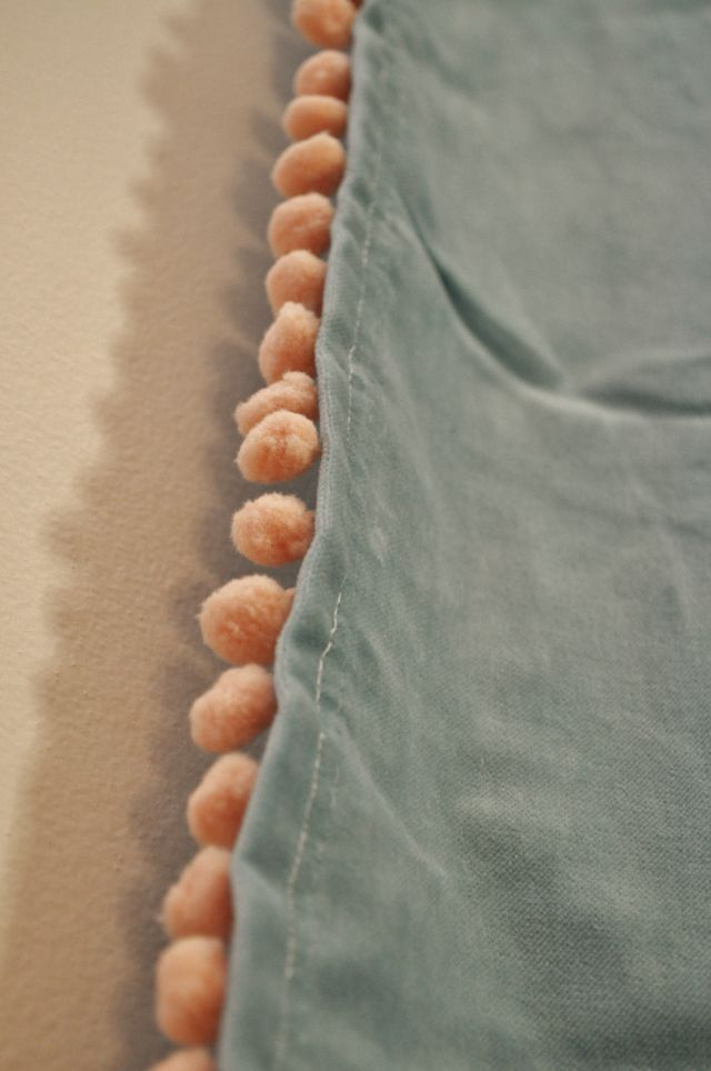Peach pompom trim sewed on IKEA turquoise velvet curtains