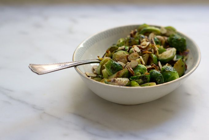 Oregano Brussels Sprouts - New year, new brussels sprouts recipe. This one pan-fried and then finished with a drizzle or oregano deliciousness, and toasted almond slices. - from 101Cookbooks.com
