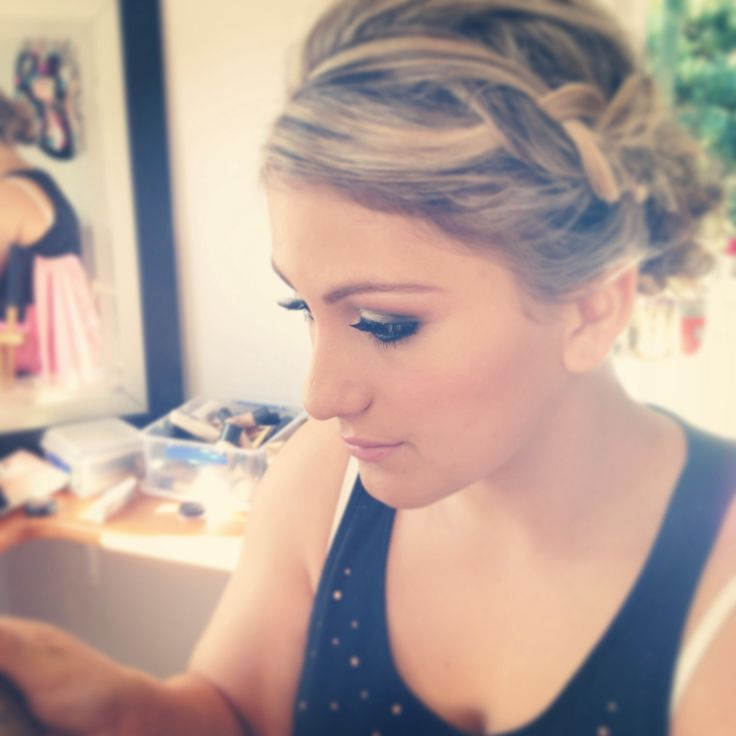 Off to the ball with a chunky braid and smoky eye.