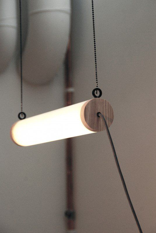 Cute simple pendant light fixture made with LED and clear wood, perfect in a kitchen or above a desk.