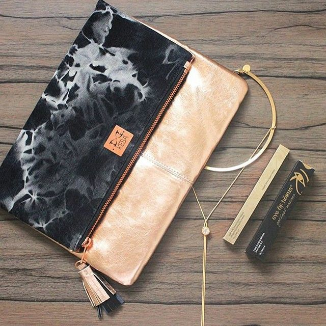 Gorgeous Marble and Gold Clutch Bag. LEERA Clutch Bag Beautiful Chaos -Bold, classy and fashion forward the range is inspired by the Edgy London look and plays on texture and contrast. Designed in Australia by Kesa  Designs. Shop for distinctive gifts by Australian designers now.