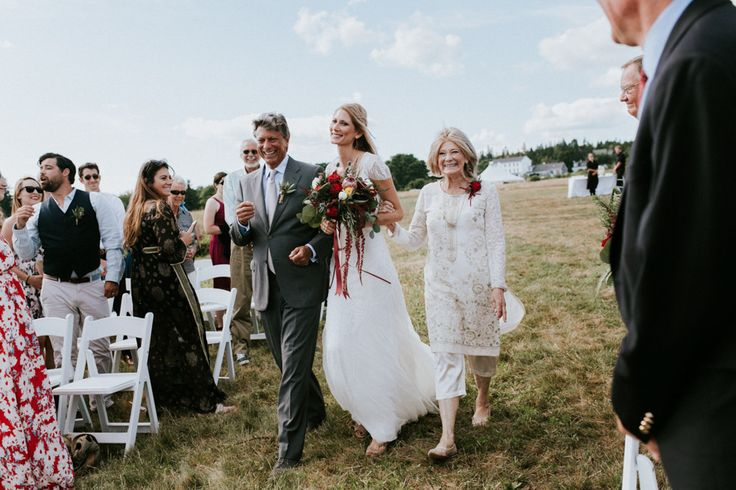 This Maine wedding features incredibly cool boho style, gorgeous bridal style, and woodland details like moss, antlers, and furry animals.