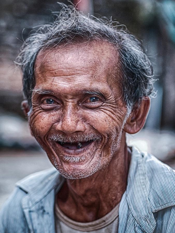 An old fisherman Nggrenehan Beach, Gunung Kidul, Yogyakarta