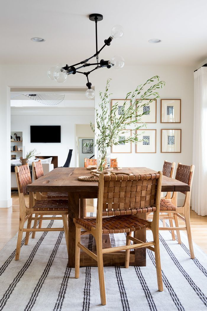 Modern Boho Dining Area With Modern Black Chandelier And Woven Leather Chairs Photo By Amy Bart Modern Dining Room Dining Room Design Dining Room Inspiration