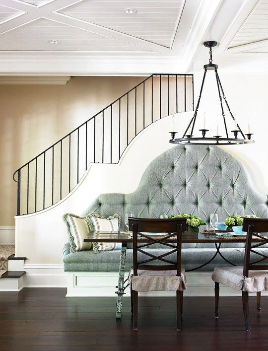 love how the shape of the wall is replicated in the banquette, cool ceiling design.