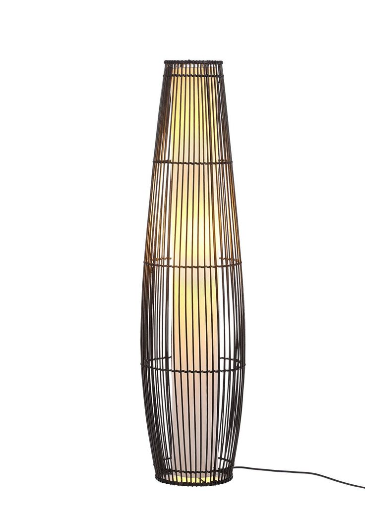Wooden wicker style floor light in brown shaped into a tapered cylinder shape with a white round cylinder shape on the middle of the wicker to encase the...