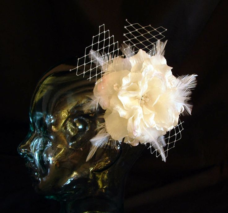 A silk flower, feathers and veiling. $75 CAD (21013)