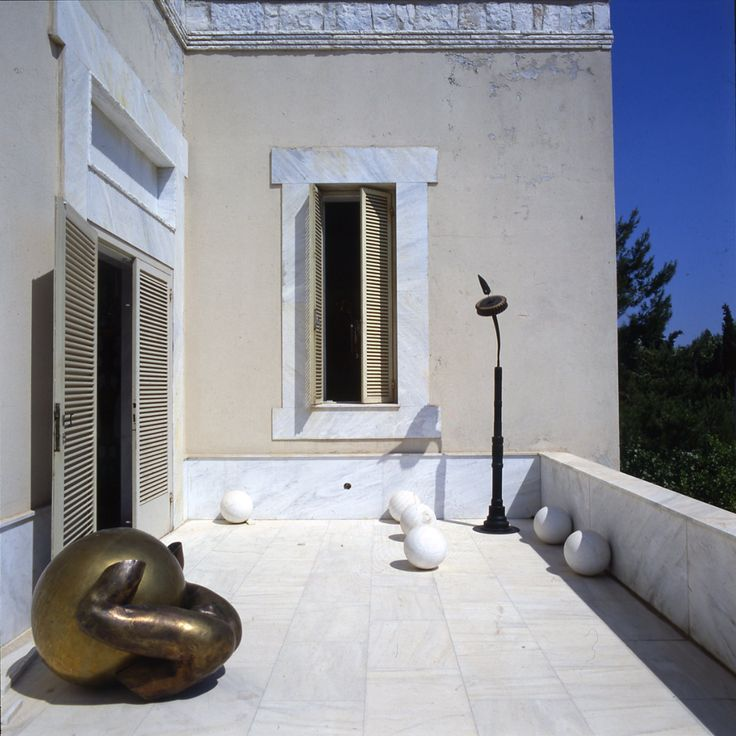 The white marble terrace with two sculptures by Takis at the home of the art collector Alexander Iolas in Greece.