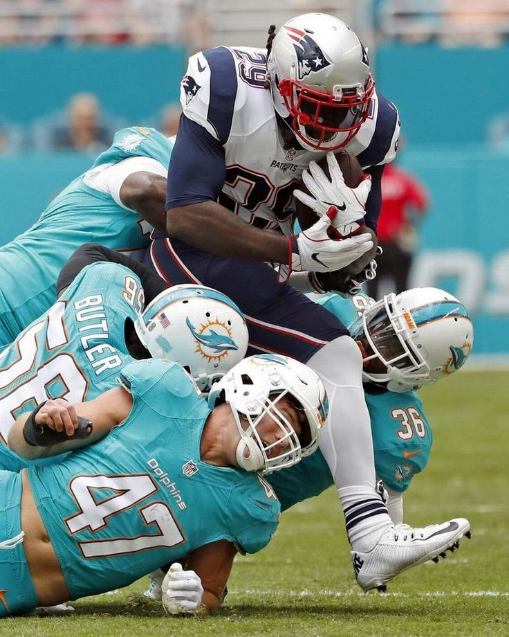 New England Patriots running back LeGarrette Blount (29) breaks tackles as he is eventually stopped by Miami Dolphins defenders in the first quarter as the Miami Dolphins host the New England Patriots at Hard Rock Stadium on Sunday, January 1, 2017.