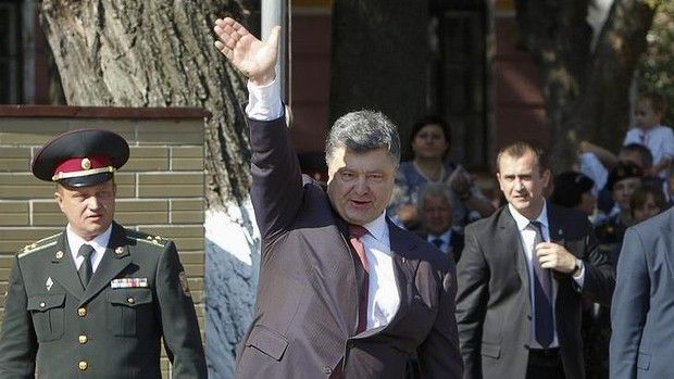 """Ukrainian President Petro Poroshenko waves to cadets in Kiev. Poroshenko accused Moscow of """"direct and open aggression"""" against his country...."""
