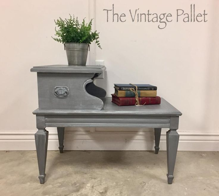Chalk Painted this vintage two tier end table Hurricane Gray and did a white wash to accent all the details.