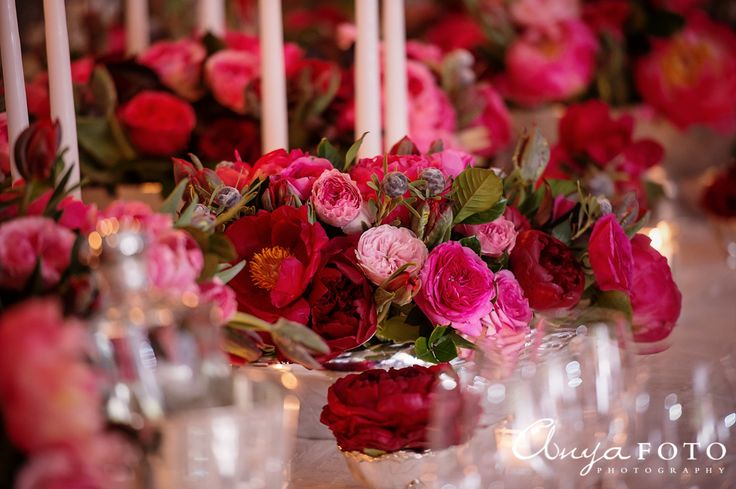 Gorgeous roses with candles as centerpieces |  Aramat Events // Images by AnyaFoto Photography // www.anyafoto.com