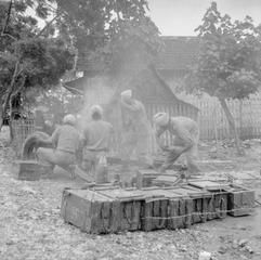 THE BRITISH OCCUPATION OF JAVA. Gunners of the 24th Indian Mountain Battery (5th Indian Division) work quickly to reload their 3.7 inch gun to lay down sustained fire on an Indonesian mortar position that had been firing onto British positions around the town of Grissee, some ten miles out of Surabaya.