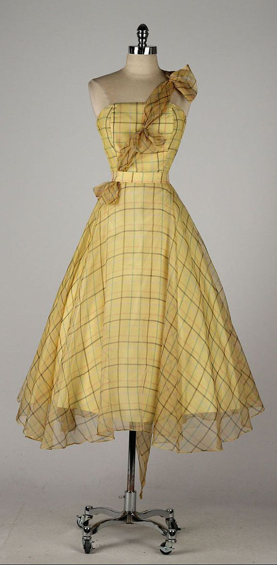 Maybe a different color. But this style is awesome! vintage 1950s yellow plaid organza dress with matching wrap