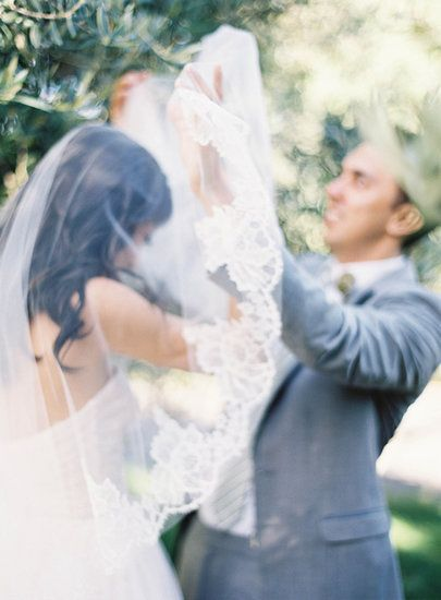 9. Lifting the Veil: Not only is the moment the veil is lifted over your head magical, but it also makes for a stunning photo. Photo by Jen Huang Photography via Style Me Pretty