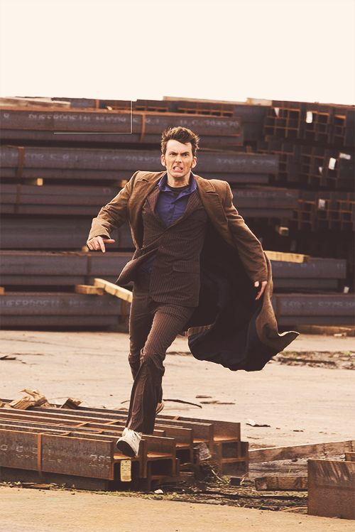 Tenth doctor (David Tennant) in dramatic running pose