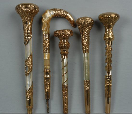 FIVE GOLD FILLED PARASOL HANDLES, 1890-1910