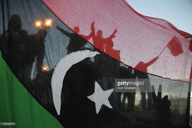 Protesters against Col. Muammar Gaddafi celebrate February 27, 2011 in Benghazi, Libya. The oppositions against Gaddafi took control of the city early last week.