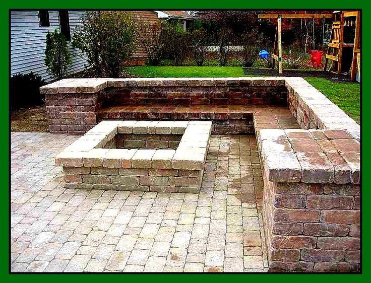 Square fire pit with square seating area backyard for Garden patio wall designs