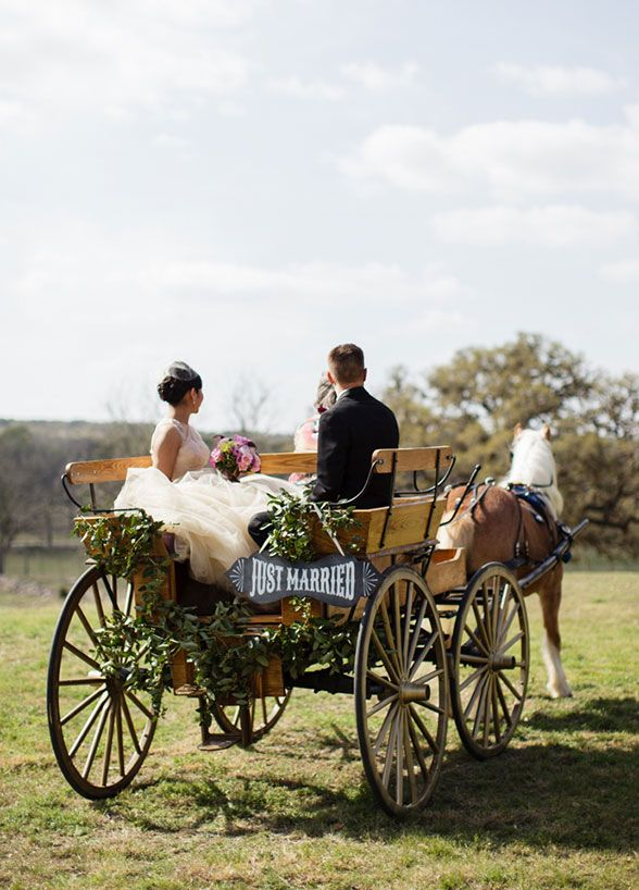 In true country style, a horse drawn carriage made for the perfect 'just married' getaway car. You don't want to miss this vintage Texas country wedding.: