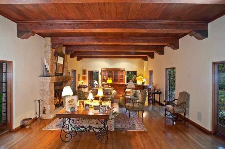 wooden ceiling beams | The living room has a wood ceiling with exposed beams.