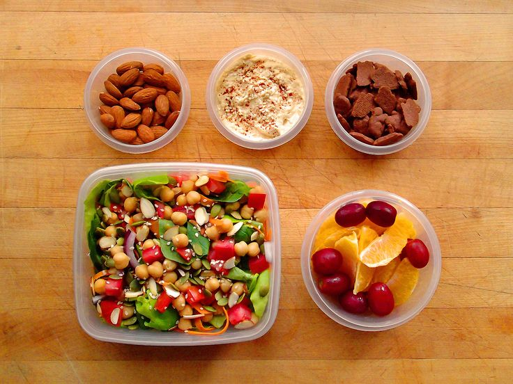 Raw almonds, Annie's Chocolate Bunny Grahams, and a navel orange with red grapes. Spinach and butter lettuce salad with carrot ribbons, chopped tomato, red onion, chickpeas, sliced almonds and sesame seeds with roasted garlic hummus for dressing.