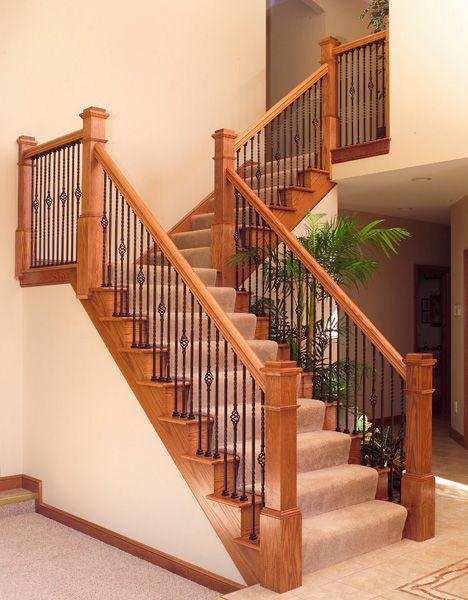 stairway features and iron balusters box newels and handrail