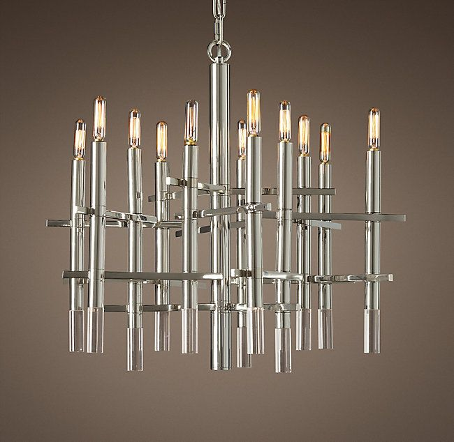 "RH's Lynx Chandelier 25"":A sleek Italian chandelier from the 1960s inspired our modern minimalist interpretation. Strong horizontals link the bold brass uprights, each finished with the flawless polish of an optical-grade crystal."