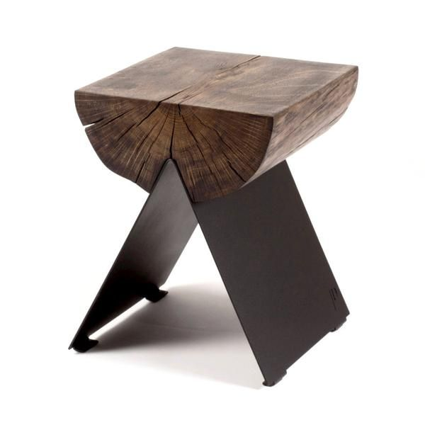 Designed by Witamina D, the graphic Half stool is made from a section of a solid oak trunk. The character of the timber contrasts with the modern metal base, which is laser-cut and powder-coated.