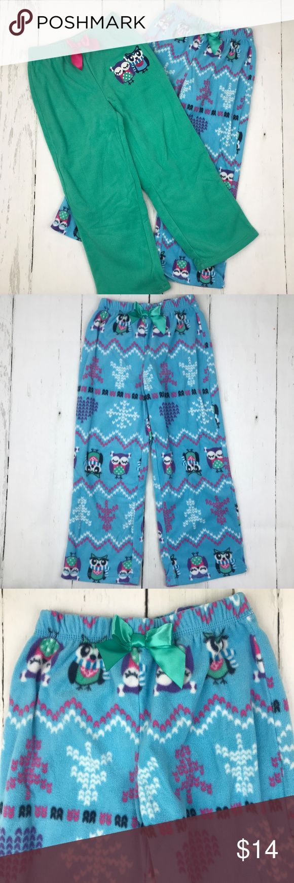 Girls Set of 2 Fleece Pajama Pants Size 7 This listing is for the set of 2 fleece pajama pants. They are new without tags and have never been worn! Elastic waist bands on both, with satin decorative tie. The blue pair has the owl designs printed on the fleece and the green pair has the two embroidered owls on the hip.   Flame resistant sleepwear.  100% polyester.  Size 7. Pajamas Pajama Bottoms