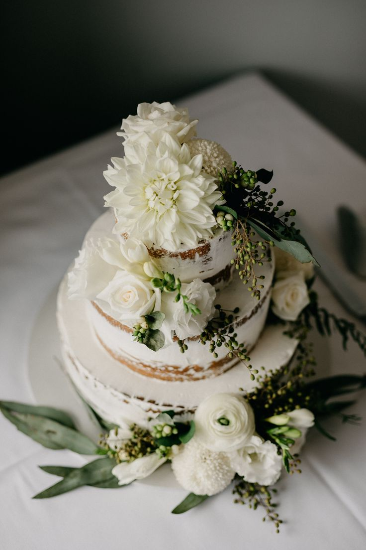 Three tier white naked cake decorated with roses, chrysanthemums, freesias and native greenery #nakedcake #white #florals #elegant #simplicity