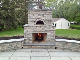 This is an outdoor stone fireplace and Pizza oven built with a unique over/under design. In St. Louis Park, MNBy English Stone