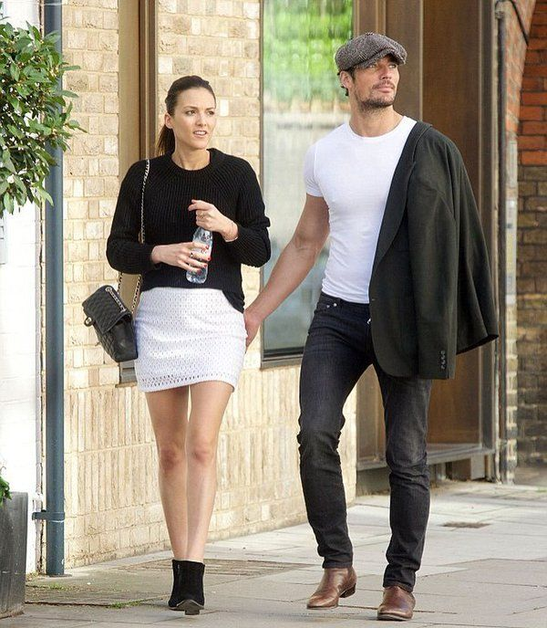 David Gandy in London on April 22, 2016.  Blossoming romance:  David Gandy, 36, looked to have landed himself a new girlfriend after he was spotted packing on the PDA with a mystery brunette on Saturday as they went for a stroll around the streets of London A source told the Daily Mirror: 'They weren't holding back – it was quite obvious they're enjoying themselves together.  'There was plenty of kissing, they were clinging to each other's hands and playfully stroking one another. It's…